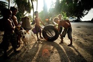 Children play on the main island of Tarawa-Kribati
