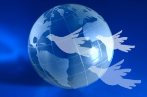 A blue globe with doves flying ahead. A global peace idea.