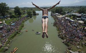 Sali Riza Grancina performs the winning jump from the Ura e Shenjte bridge