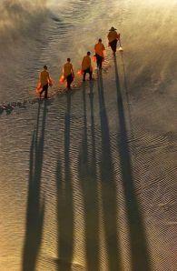 Walking monks on desert