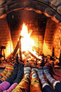 by the fire with friends
