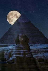 A moon rise over the Great Pyramid of Giza over the Sphinx in Egypt