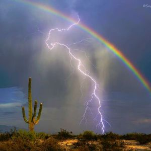 lightning and a rainbow in Tucson, Arizona (Photo via Instagram by @tucsonre)